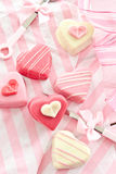 Pink Petit Fours in Heart shape. Colorful petit fours in heart shapes on pink Royalty Free Stock Photos