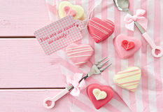 Pink Petit Fours in Heart shape. Colorful petit fours in heart shapes on pink Royalty Free Stock Images