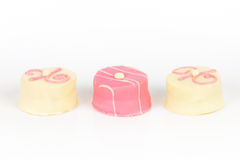 Pink petit fours. Three pink petit fours isolated Stock Image