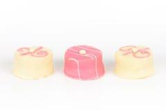 Pink petit fours Stock Image