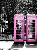 Pink phone booths in London Stock Photo