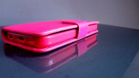 Pink phone - cover. Pink phone reflection Royalty Free Stock Image