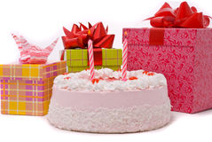Pink Pie With Two Candles And Gifts In Boxes Royalty Free Stock Images