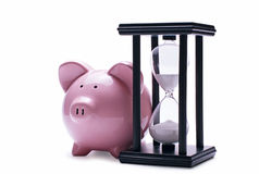 Pink pig piggy and old hourglass Royalty Free Stock Photography