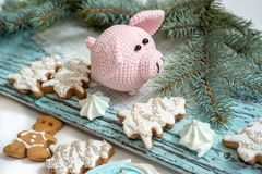 Pink pig, symbol of 2019. Happy New Year. Crochet toy for child. On table threads, needles, hook, cotton yarn. Handmade crafts on. Holiday with your own hands royalty free stock photos