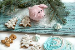 Pink pig, symbol of 2019. Happy New Year. Crochet toy for child. On table threads, needles, hook, cotton yarn. Handmade crafts on. Holiday with your own hands stock image