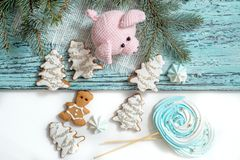 Pink pig, symbol of 2019. Happy New Year. Crochet toy for child. On table threads, needles, hook, cotton yarn. Handmade crafts on. Holiday with your own hands royalty free stock photo