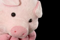 Pink piggy. Soft toy on black background Royalty Free Stock Image