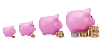 Pink piggy bank. Different banks - different money Royalty Free Stock Image