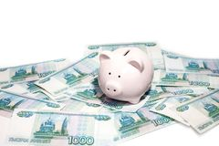 Pink piggy bank with a banknote royalty free stock photography