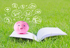 Pink piggy bank on booklet and icon design Royalty Free Stock Image