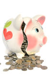 Pink piggy bank broken with money Royalty Free Stock Image