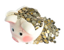 Pink piggy bank broken with money Royalty Free Stock Photography