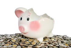 Pink piggy bank broken with money Stock Photography