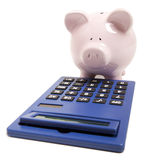 Pink piggy bank and calculator Stock Photo