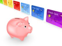 Pink piggy bank and colorful credit cards. Royalty Free Stock Photography