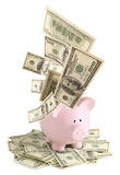 Pink piggy bank on dollars Royalty Free Stock Photos