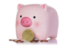 Pink piggy bank and Euro currency coins Royalty Free Stock Images