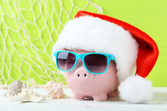 Pink piggy bank. With glasses on white wooden background Royalty Free Stock Images