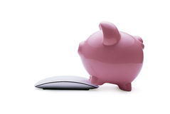 Pink piggy bank investing in savings online Stock Images
