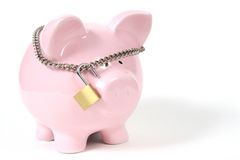 Pink Piggy Bank with Lock on white background. Pink Piggy Bank on isoalted on white background with lock Stock Photos
