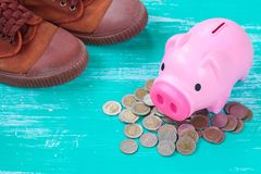 Pink piggy bank over coins stack, saving money. Concept Royalty Free Stock Photos