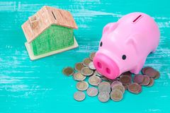 Pink piggy bank over coins stack, saving money. Concept Royalty Free Stock Photo