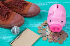 Pink piggy bank over coins stack, saving money. Concept Stock Images