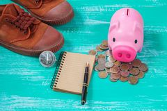 Pink piggy bank over coins stack, saving money. Concept Stock Photos