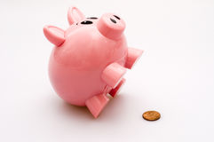 Pink Piggy Bank and Penny. A pink piggy bank sitting up and a copper penny coin Royalty Free Stock Photo