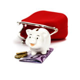 Pink piggy bank and red purse Royalty Free Stock Images