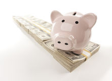 Pink Piggy Bank on Row of Money Royalty Free Stock Images