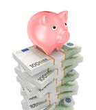 Pink piggy bank and stacks of euro. Royalty Free Stock Photography