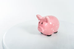 Pink piggy bank standing on white with copy space Royalty Free Stock Photo