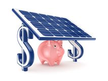 Pink piggy bank under solar battery. Royalty Free Stock Photos