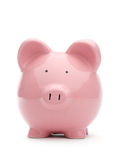 Pink piggy bank. On white background Stock Photos