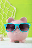 Pink piggy bank. On white wooden background Stock Images