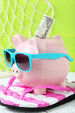 Pink piggy bank. On white wooden background Stock Photos