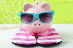 Pink piggy bank. On white wooden background Stock Image