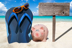Pink piggy bank and wooden Signboard Royalty Free Stock Photos