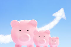 Pink piggy banks with sky and cloud arrow Royalty Free Stock Image