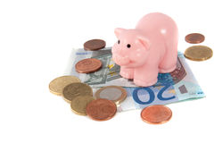 A pink piggy on top of  saving euro banknotes Stock Photo