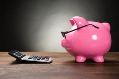 Pink Piggybank And Calculator Royalty Free Stock Photo
