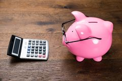 Pink Piggybank And Calculator Royalty Free Stock Images