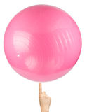Pink Pilates Ball At Tip Of Finger Royalty Free Stock Photography