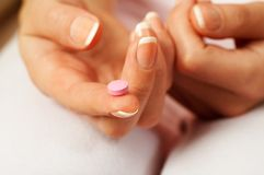 Pink pill Royalty Free Stock Images