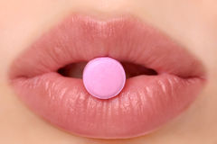 Pink pill Stock Photography