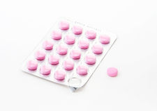 Pink pill with pack Royalty Free Stock Image