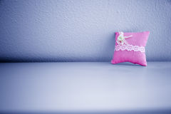 Pink Pillow on Wall Stock Photo