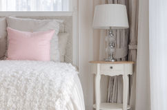 Pink pillow on white luxury bed in bedroom Stock Image